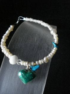Hand made bracelet of fresh water pearls,turquoise and silver 925 heart with cold enamel and liquid glass Made by Eirini Svarnia. Price 35.00 euro