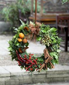 London florist Moyses Stevens has been producing stunning arrangements since Their traditional festive wreath, with different ornaments adorning each section, wouldn't have looked out of place at a Victorian Christmas. Christmas Door Wreaths, Noel Christmas, Holiday Wreaths, Handmade Christmas, Christmas Crafts, Christmas Ornaments, Christmas Swags, Burlap Christmas, Simple Christmas