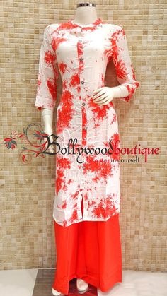 Designer Kurti 67 Fabric : Cotton Reyon. Color : White / Red. Style : Designer Long Kurti. Product Details : Designer long kurti ideal for everyday use as well as small get together. Batik printed designer long kurti. Price : Rs: 720 / –