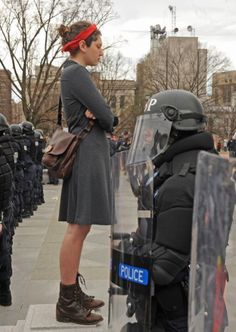 Woman standing in defense of women's rights against recent attacks. Picture was taken at VA state capital, March 3, 2012. 31 people arrested.  This powerful picture was taken by Scott Elmquist/Style Weekly.
