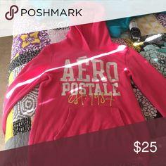 Aeropostale hoodie a pretty, pink Aeropostale hoodie. Very warm and soft. Keeps you really warm in the winter. Aeropostale Tops Sweatshirts & Hoodies