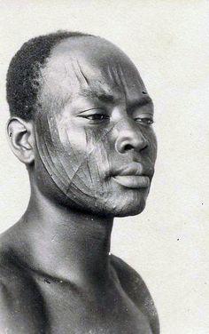 Africa | Facial scarification. Douala, Cameroon || Scanned postcard. Photo R. Pauleau.