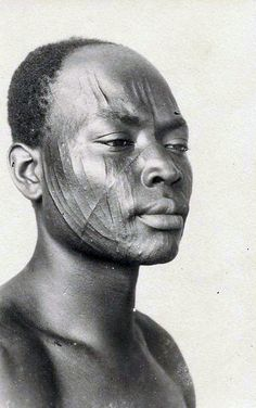 Africa | Facial scarification. Douala, Cameroon || Scanned postcard. Photo R. Pauleau.