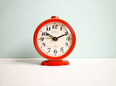 Vintage Big Mechanical Alarm Clock Red Beige White Russian Wind Up 70s. €35.00, via Etsy.