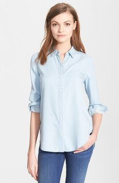A classic menswear silhouette—point collar, button placket, the works—is feminized by fluid Tencel® construction in a shade of indigo. Cuffable sleeves and a tuckable shirttail hem keep your styling options open. http://shop.nordstrom.com/s/ayr-the-clean-shirt/3928349