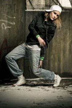 street dancer wearing hiphop clothes striking a pose