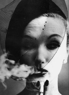Irving Penn Photography #face #looking #side #retro #bw #light #shadow #hat #fascinator #veil