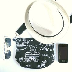 This quirky pig print sling bag is the perfect accessory for a day out in the city! You can travel light with this chic cross body pouch bag - throw in your phone, purse, lipstick, and even a Kindle for an avid reader, and you are set for a day of shopping and rest breaks lying in a shady spot for a leisurely read in the park. The cotton canvas outer is stabilised with premium fusible fleece, giving it a lovely padded and soft touch. The bag is lined with a black and white polka dot fabric…