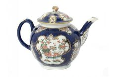 LOT 82 A WORCESTER GLOBULAR SCALE BLUE GROUND KAKIEMON TEAPOT AND COVER, C1770 with flower knop, 14.5cm h, underglaze blue fretted square  ++Minute nicks on tip of spout, a fine teapot
