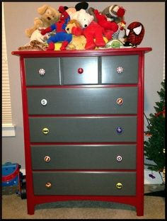 I like the idea of painting the dresser in solid colors and just having the superhero knobs... Much easier to switch knobs out when the boys want a new theme