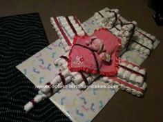 Homemade F15 Diaper Cake Design: My friend asked me to make a cake that looks  like F15 and this F15 Diaper Cake Design is what I came up with. I bought about 4 packs of diapers 2x newborn