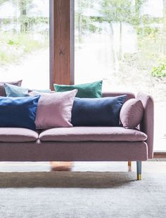 Think pink | Mid-century modern house | huge windows | pink sofa with multi-coloured scatter cushions | IKEA Söderhamn sofa with a Bemz Respect cover in Rosewood Lunda Melange