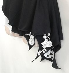 This listing is for a beautiful, brand-new black and white figure skating costume. Dress is constructed of black Lycra with a sweetheart neckline, and features white lace detail on the bodice, neckline, back, and skirt. In the front, lace was used to trim the sweetheart shape and