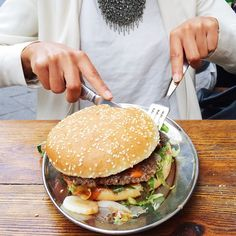 Woman is eating a huge burger