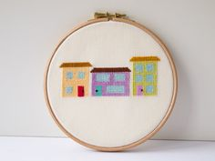 The Street Where You Live cross-stitched houses in by Hextrovert, Wooden Hoop, Pastel Colors, Coin Purse, My Etsy Shop, Cross Stitch, Buy And Sell, Embroidery, Fabric, Crafting