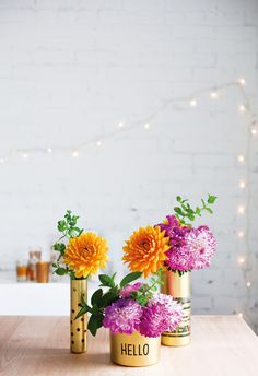 Gold vases and bright blooms.