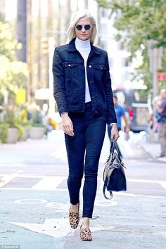 Natural beauty:The model flaunted her long legs in the fitted dark wash bottoms, adding a...