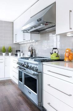 White acrylux high-gloss kitchen cabinets paired with Top Knobs cabinet pulls #modern #kitchen : Connecticut Cottages & Gardens