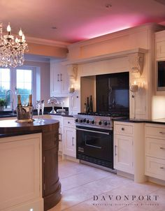 Colour change lighting was installed above the cooker and fridge units. As Nicki was keen to create a space designed to entertain in, finishing touches like this gave the room an instant party atmosphere.