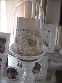 Petite vignette under glass...this could be really pretty at the shower or wedding maybe if you like :)