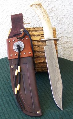 Beautiful custom made Damascus Steel Knife with authentic polished deer antler handle and custom fitted sheath