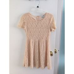 Lace Dress This lace dress has an attached slip under it but still requires nude colored underwear. The sleeves go midway down the upper arm and midway down the thighs. Very comfy and classy! Forever 21 Dresses Midi