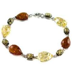 Multicolor Amber Sterling Silver Drop Bracelet. Amber is the lightest and warmest stone that exists, which makes it the most comfortable and attractive gem in jewelry. Amber is good to wear for any everyday life occasion. Bracelet Dimensions Width 0.99 cm Length 19.5 cm Weight 12 gr.
