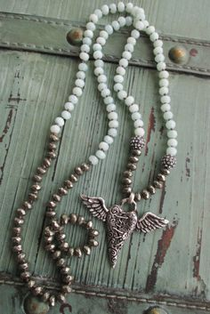 Knotted broken winged heart long necklace Love by slashKnots