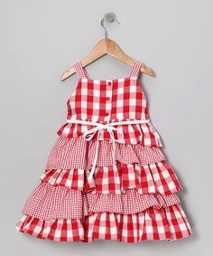 This charming frock will look smartly sweet on any little lady. Kissed with contrast prints, asymmetrical ruffles and a handy back closure, this playful piece is one genius style choice.