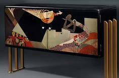 French Art Deco lacquered radio cabinet with abstract decoration – Jean Dunand  1930