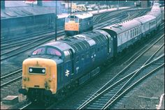 Photos on this page from Spittle bridge near Peterborough railway station in the BR blue years. Class 55 Deltic out of platform 3 at Peterborough onto the down fast and a Class 47 starting out from platform 4 . Electric Locomotive, Diesel Locomotive, Railroad Pictures, British Rail, Train Pictures, Train Engines, London Bus, Train Journey, Train Layouts