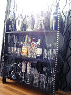 Before and After: Bookshelf to Bar. I would happily decorate it like this and keep it as a bookshelf.