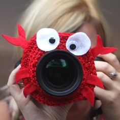 Camera lens buddy. Crochet lens critter red crab. Photographer helper. $12.99, via Etsy.