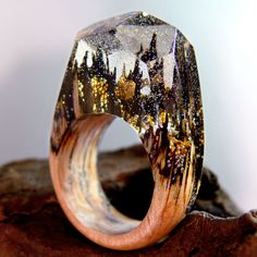 Golden Castles Wooden Resin Ring made with Birch wood and gold flakes by RingsofNature on Etsy https://www.etsy.com/listing/479134839/golden-castles-wooden-resin-ring-made
