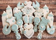 Baby boy decorated sugar cookies. Royal icing. Blue, white. Onesie, bottle, rattle, heart, diaper pin, bib, baby feet.