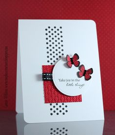 delightful handmade card ... clean and simple ... white with red and black ... luv the various textures and layers for the central montage ...