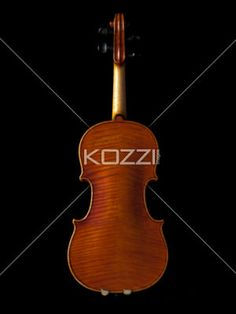 image of a violin on black background. - Back side of a old fashioned wooden violin isolated on dark background.