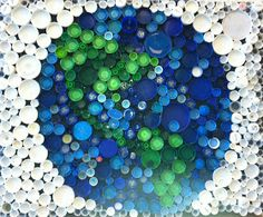 I am so exited about our Earth Day project!  The Environmental Club created this mosaic out off recycled bottle caps to show at the Commun...