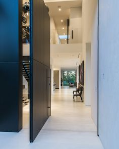 Check out the giant panel door in this Beverly Grove Residence (in Beverly Hills, California USA)