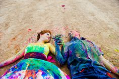 Newlywed couple did a photo shoot in which they had a paintball fight, to turn her wedding gown into a work of art. The dress is now displayed on a mannequin in their home... Crazy! But still cute! Jenn you need to do this after the wedding!!!