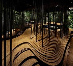 Ryoji Iedokoro Architecture Office have created a mesmerising interior for a yakiniku restaurant in the heart of Tokyo's Roppongi district.