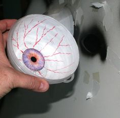 Do-It-Yourself Halloween Decoration How-To Tips: Being EYEd - It will appear as if the creature is watching you as you move around.