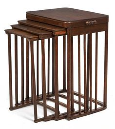 Josef Hoffmann, four nesting tables no. 986, designed in 1906, executed by J. & J. Kohn, Vienna, beechwood, dark brown stained, traces of use, the underside of the smallest table with remains of an old label, height 74.5 cm, length 60 cm, width 43.5 cm  |  SOLD $3,350 Nov. 3, 2015