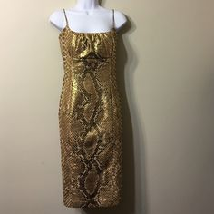 Stunning dress in Gold Metallic Python print NWOT TRACY Reese cocktail dress in metallic snake print .Made from silk blend fabrics,this dress is perfect for New Years party  ,or other occasions.Spaghetti straps,lightly padded ruched bust,boned support at the sides,low back with bow detail ,slim fit ,knee length hem.Fully lined,zipper,it is really stunning in person .Perfect condition . Tracy Reese Dresses
