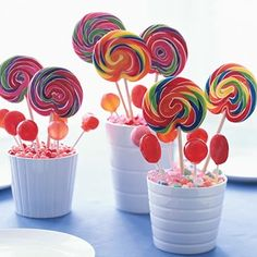 Fun centerpieces for a childrens party.  These would be cute for a party themed for Wizard of Oz, also.  It looks like the Lollipop Guild has visited!  How about for a childs table at holidays like Christmas and Thanksgiving.
