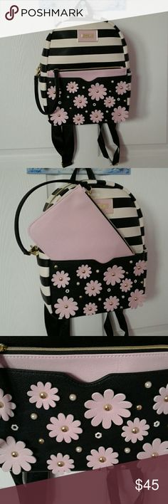 Betsey Johnson backpack Black and white backpack with light pink flowers and matching bag. This one is new and never used, it still has the brown tissue paper inside that keeps it firm. Bags