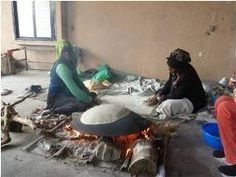 Microcredit clients working by the fire. They are clients of KIEDF which aims to help marginalized communities such as Arab Bedouin and Arab-Israeli villages in Israel.