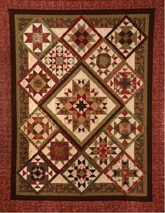 """On Point is a diagonal set quilt, made from 14 framed pieced blocks, surrounding a large pieced star or graceful rose applique center. With pieced setting triangles and squares make a 80"""" x 101"""" quilt. Designed as a 9 month, block of the month, this is the complete pattern set."""