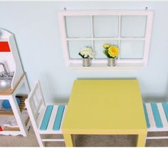 Kids pretend window for play kitchen area. Soup cans for flower vases.  So sweet!