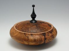 red oak, african blackwood [A great example of not attempting to hide the seam between lid and base; highlight it].